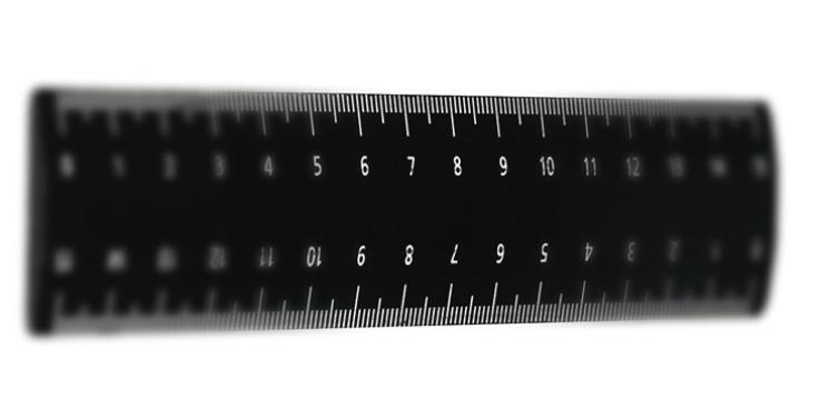 Рис. 6а. Фотография линейки с цифровым значением диафрагмы f\4.